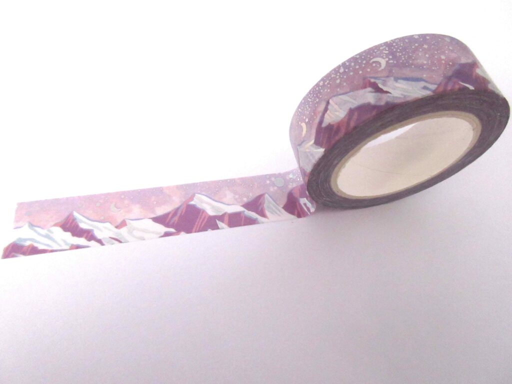 Washi tape with purple mountains and a night sky, containing moons and stars
