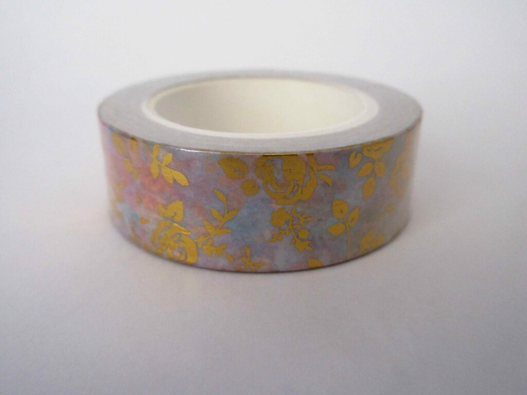 Washi tape with a gold rose design