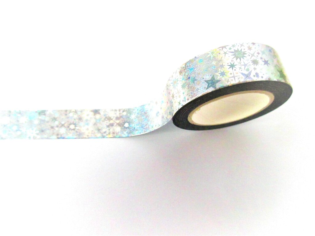 A holographic washi tape, with stars of varying sizes