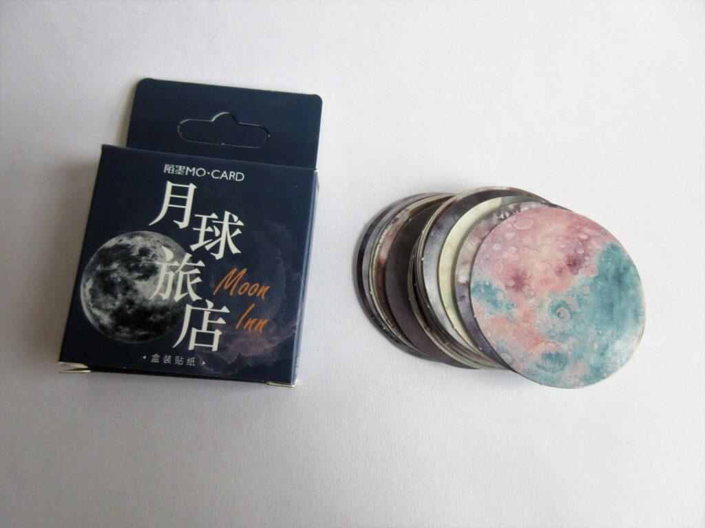 Moon and planet stickers, along with their packaging
