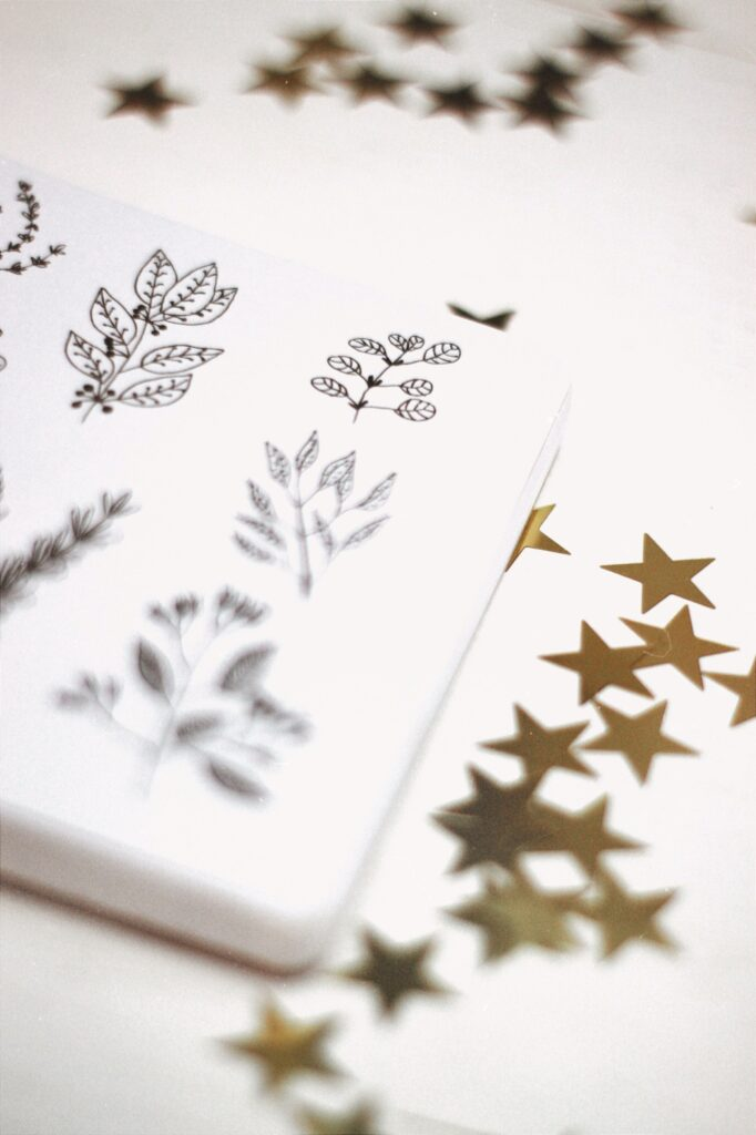 Bullet journal with plant illustrations and gold stars