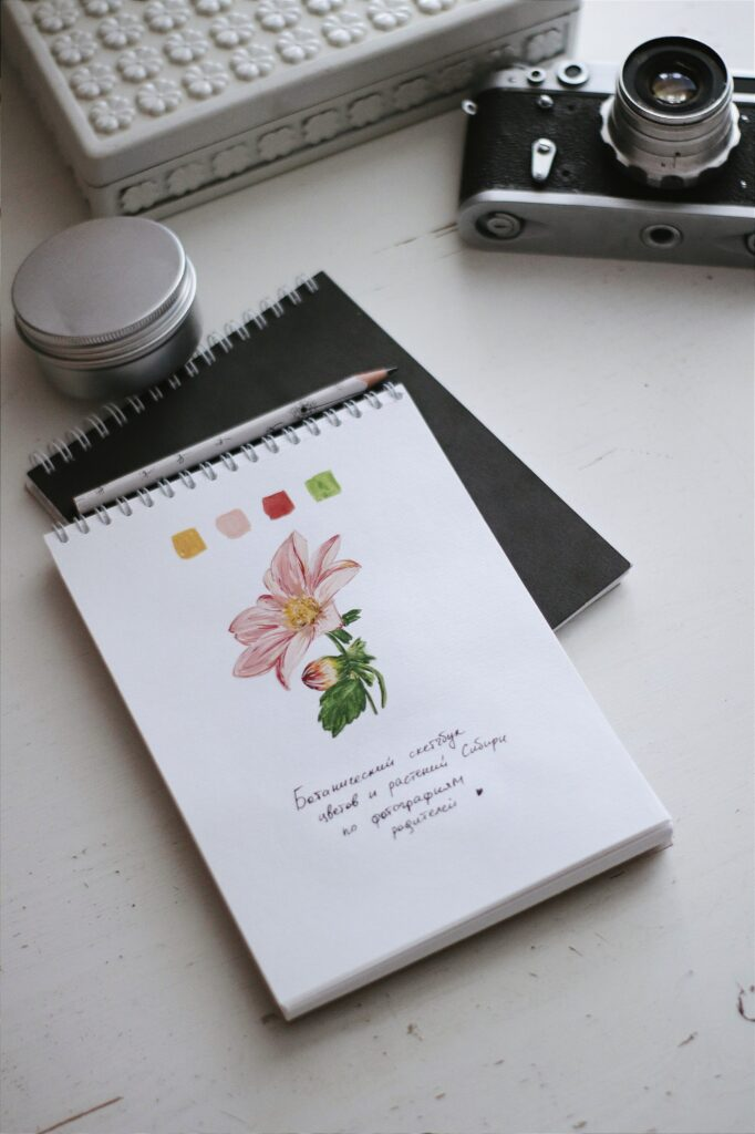 Sketchpad with flower illustration and color swatch